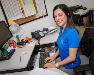 Smiling Employee on Computer